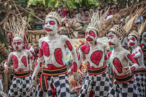 MAGELANG-INDONESIA, August 24, 2014. Participants perform during the 13th Five Mountains Festival or Festival Lima Gunung in the Muneng Warangan village of Magelang Regency. Held for the first time in 2002, the festival is the platform for local villagers and rural communities to showcase their own folk art and cultural performances in the warmth of a traditional village ambiance on a simple stage and gardens. The festival received its name from the 5 imposing mountains that surround the regency of Magelang, which are: Merapi, Merbabu, Andong, Menoreh and Sumbing.