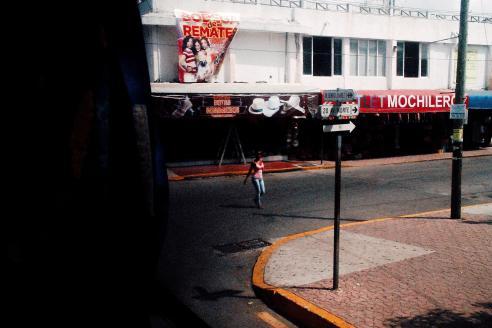 Girl walking in the street of Playa del Carmen in the morning sun.