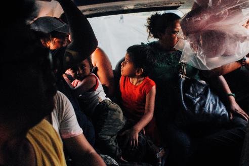 """Mexican workers going back home in a """"collectivo"""". Cancun, Mexico."""